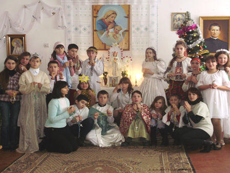 On the picture there are the members of the High School # 24 during the performance dedicated to Virgin Mary and saint Philomena in our chapel in the school. The teacher Nataliya Dzombak on the left.